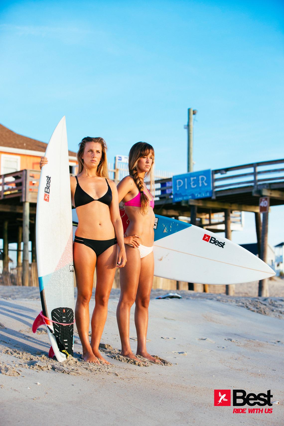 Two Best Kiteboarding kitechicks in bikini with surfboards looking to take a ride