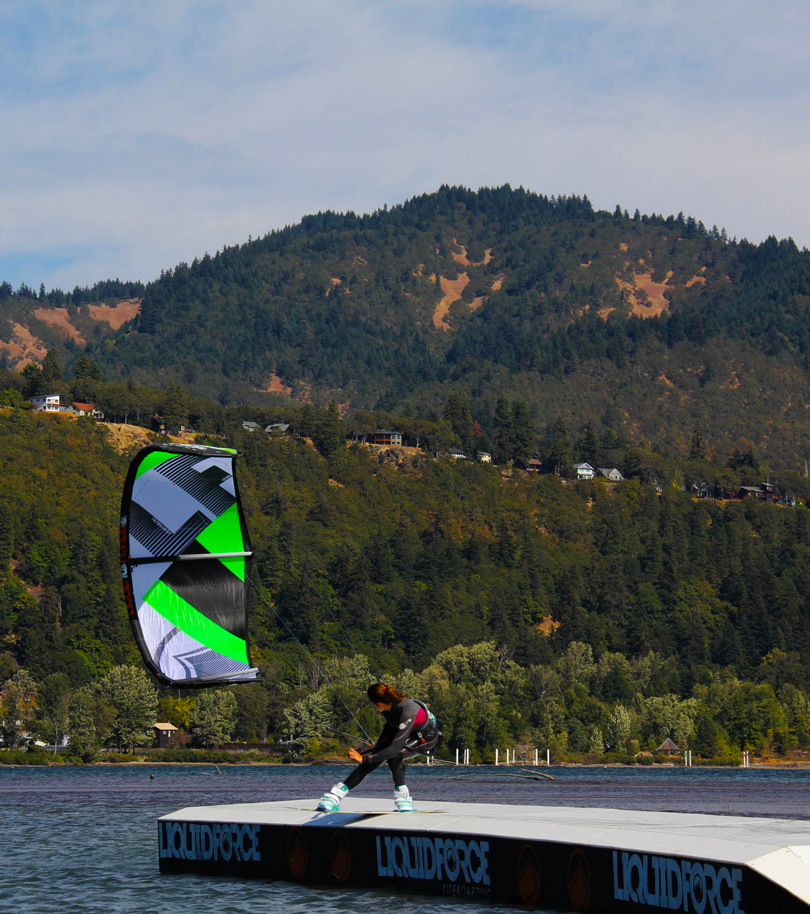 Sensi Graves kiteboarding on the slider with her Liquid Force kite
