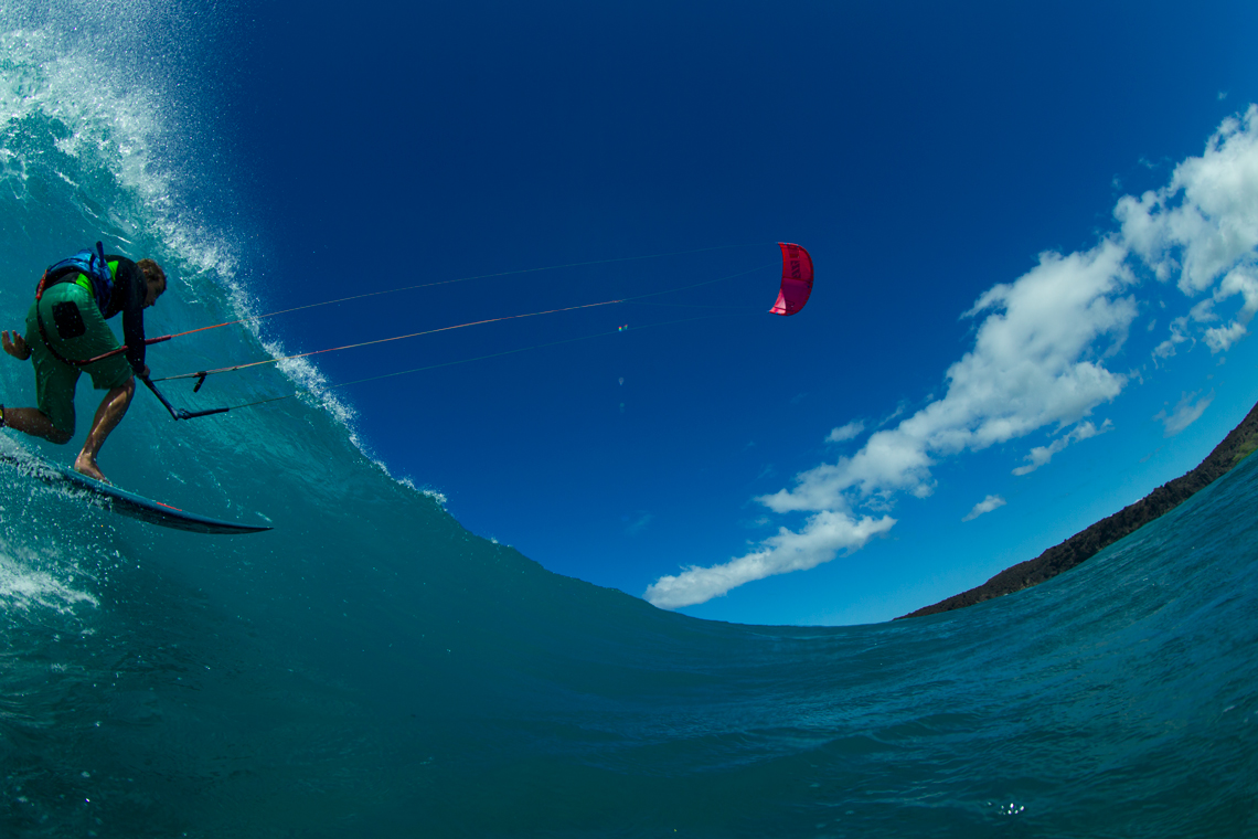 A kiteboarder - Patri Mclaughlin - with the North Kiteboarding 2016 Neo kite riding a wave.