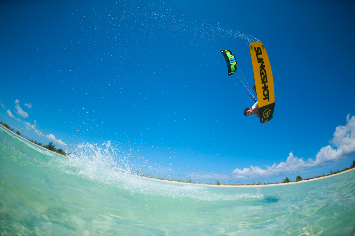 Kiteboarder Victor Hays with a jump and tail grab on the 2016 Slingshot Rally kite and Misfit kiteboard.