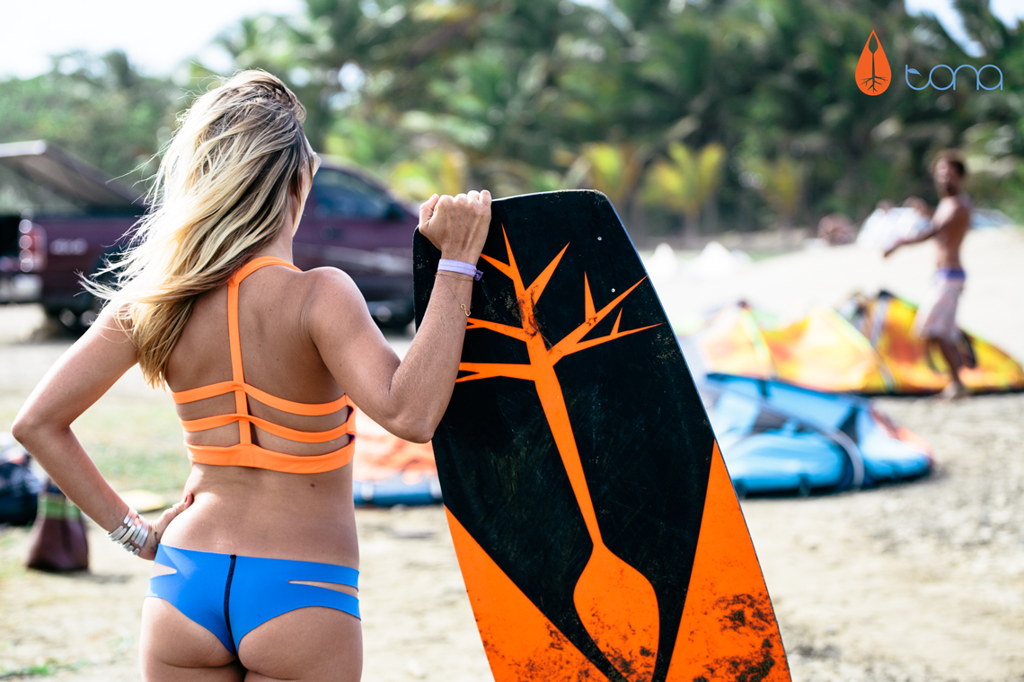 Susi Mai getting into the flow of Tona Boards posing with kiteboard