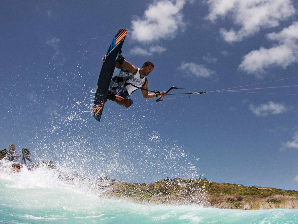 kitesurf wallpaper image - Andre Phillip with a nice grab over the surf - in resolution: iPad 1 1024 X 768