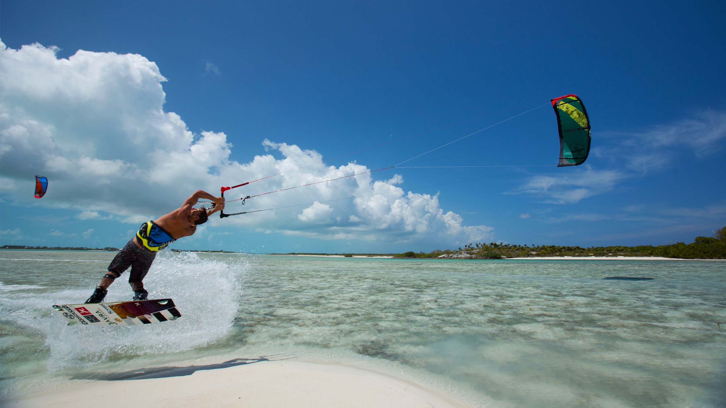 kitesurf wallpaper image - Kiteboarder Youri Zoon popping a jump over a tropical sandbar on his Best Kiteboarding gear. - in resolution: High Definition - HD 16:9 2400 X 1350