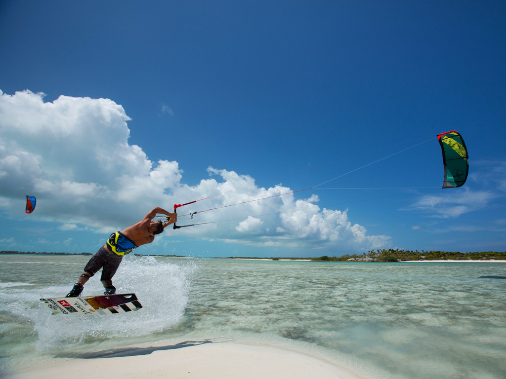 kitesurf wallpaper image - Kiteboarder Youri Zoon popping a jump over a tropical sandbar on his Best Kiteboarding gear. - in resolution: iPad 1 1024 X 768