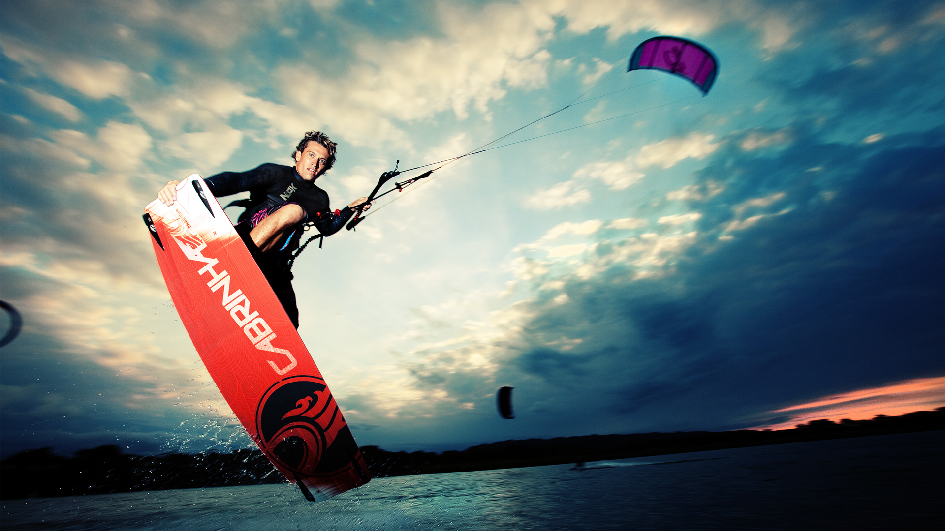 kitesurf wallpaper image - Damien LeRoy with a tailgrab at dusk on his Cabrinha kites gear - in resolution: High Definition - HD 16:9 1920 X 1080