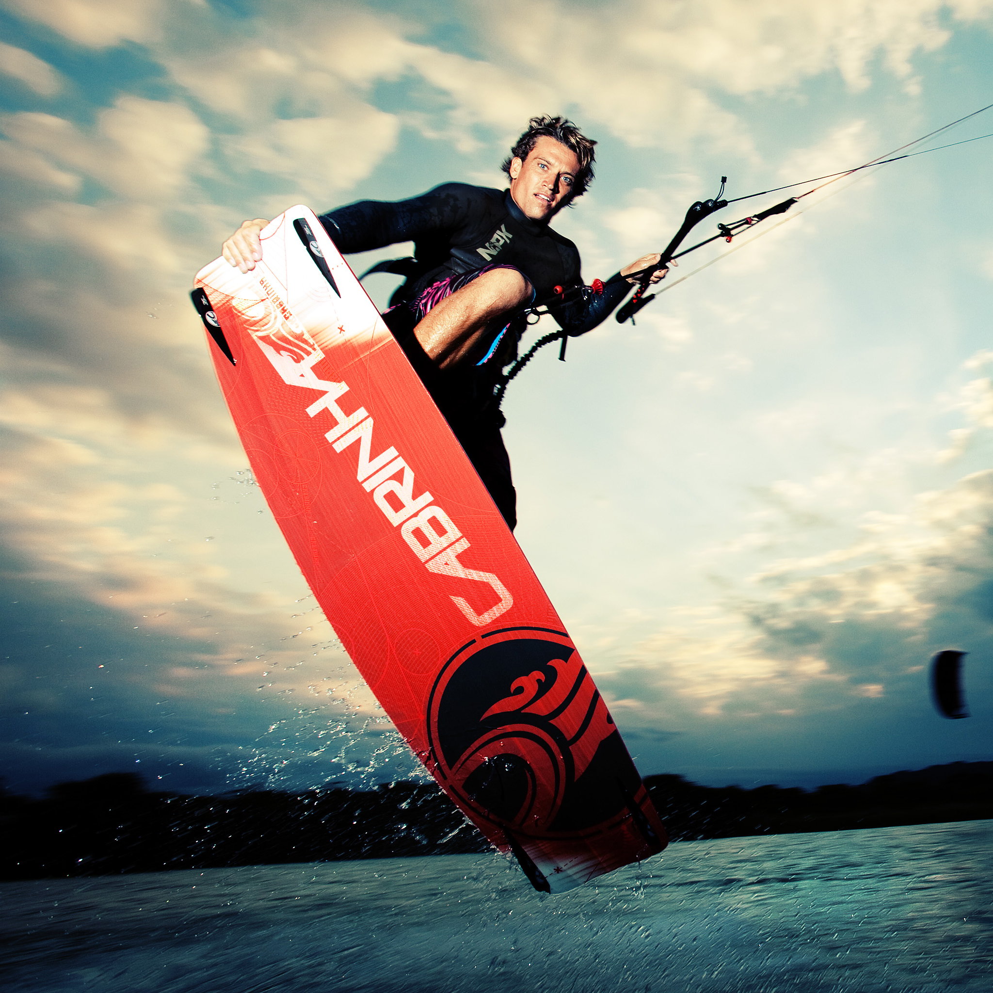 kitesurf wallpaper image - Damien LeRoy with a tailgrab at dusk on his Cabrinha kites gear - in resolution: iPad 2 & 3 2048 X 2048