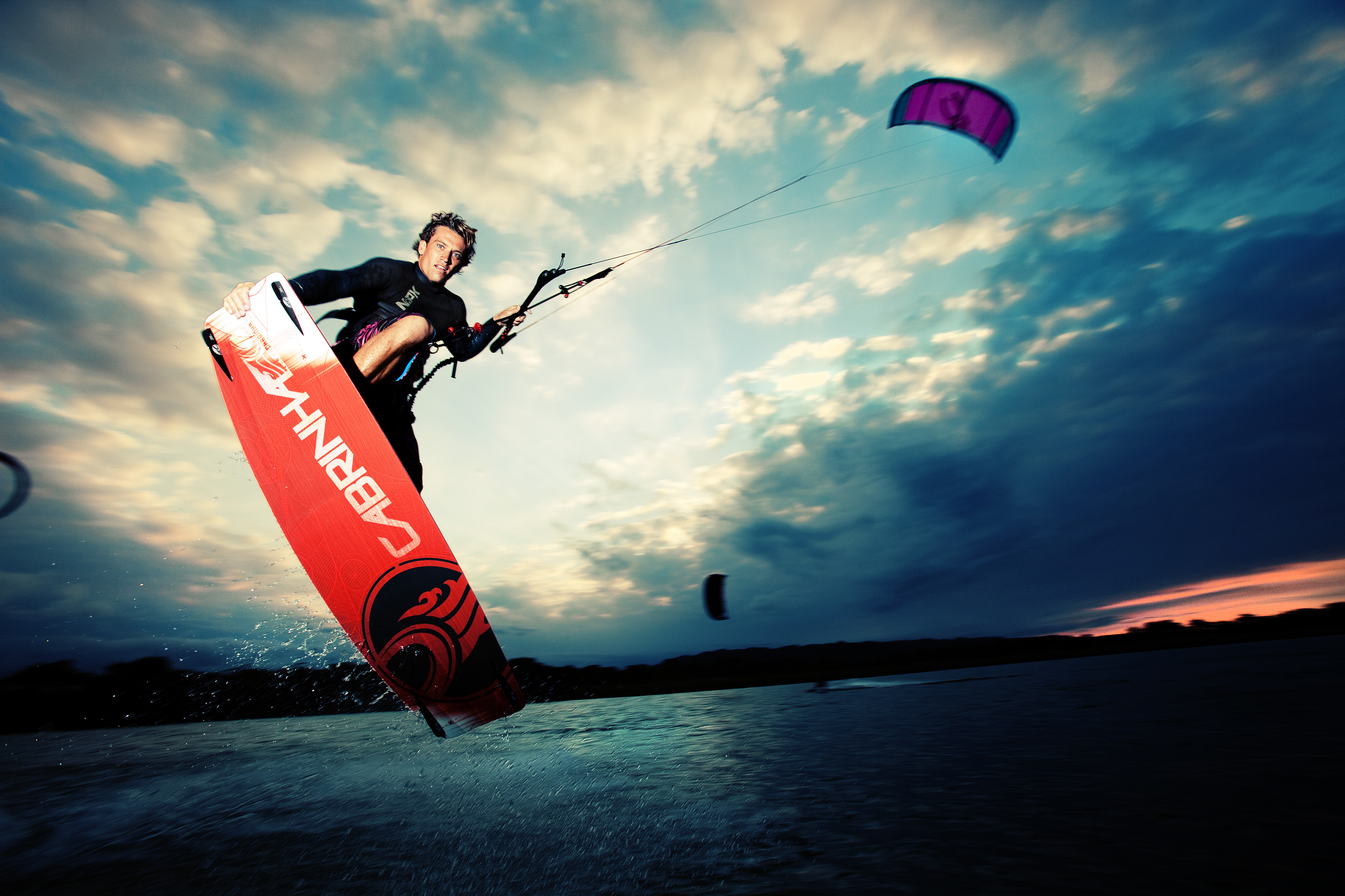 kitesurf wallpaper image - Damien LeRoy with a tailgrab at dusk on his Cabrinha kites gear - in resolution: Original 4096 X 2731
