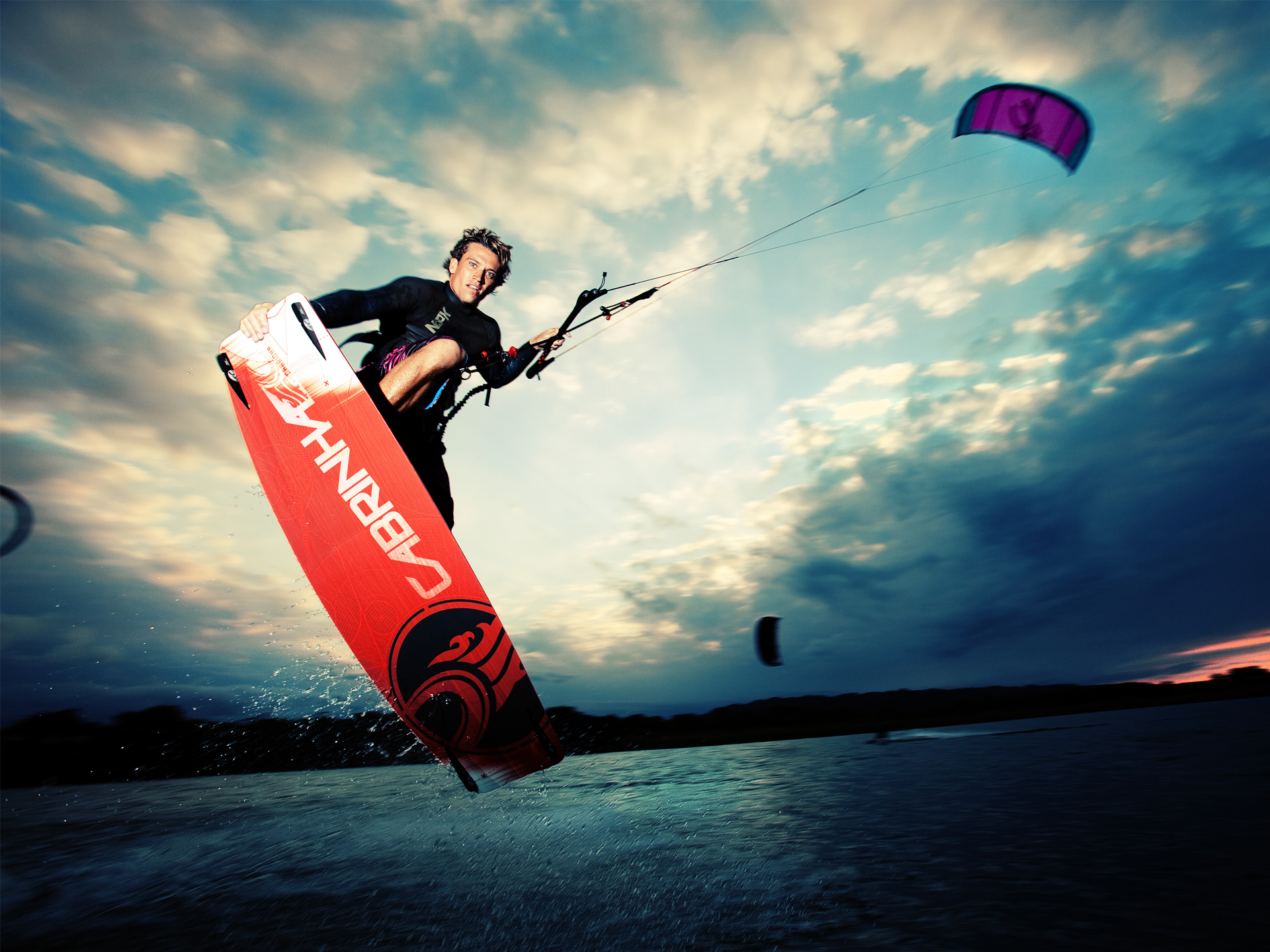 kitesurf wallpaper image - Damien LeRoy with a tailgrab at dusk on his Cabrinha kites gear - in resolution: Standard 4:3 1920 X 1440