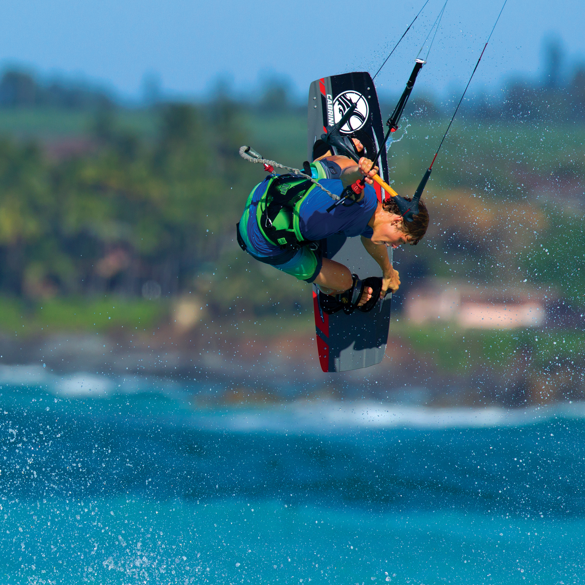 kitesurf wallpaper image - Liam Whaley on the 2015 Cabrinha Ace twintip with a nice board grab. - in resolution: iPad 2 & 3 2048 X 2048