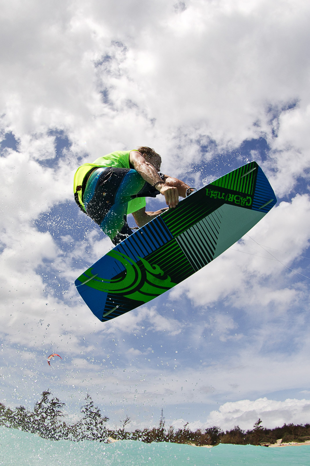 kitesurf wallpaper image - Alberto Rondina flying over tropical water on his Cabrinha kite - in resolution: iPhone 640 X 960