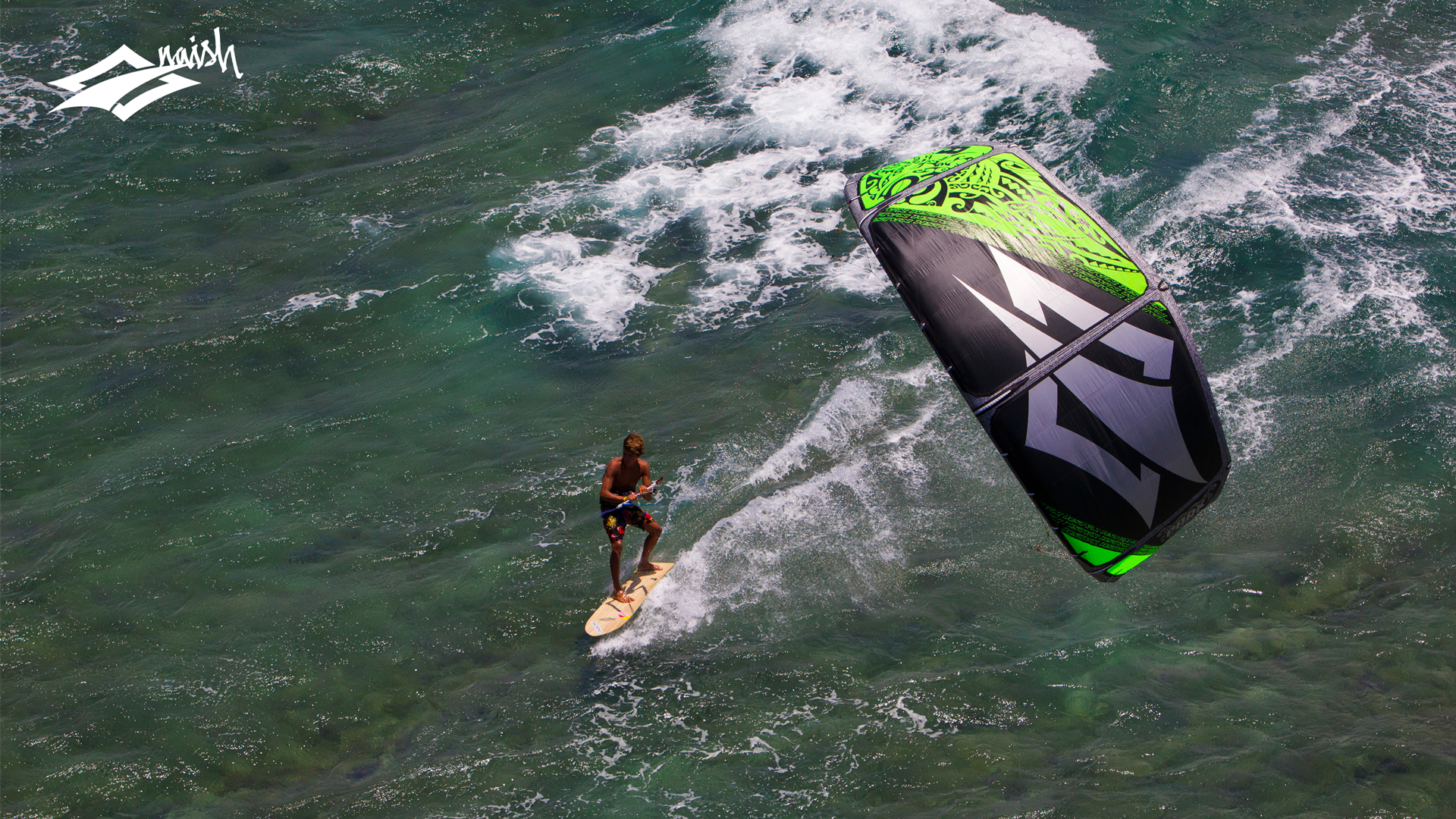 kitesurf wallpaper image - Kai Lenny cruising with the Naish Park kite and Alaia kiteboard off Hawaii - in resolution: High Definition - HD 16:9 1920 X 1080