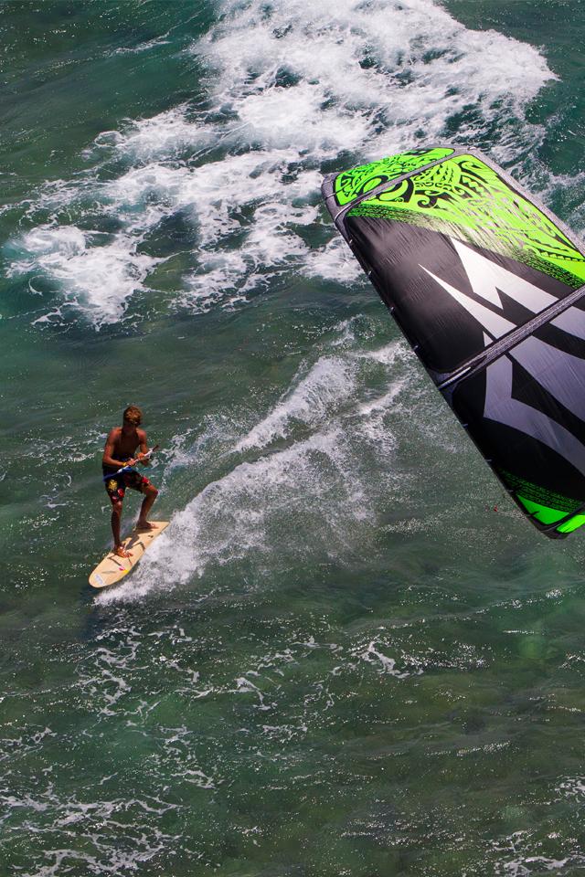 kitesurf wallpaper image - Kai Lenny cruising with the Naish Park kite and Alaia kiteboard off Hawaii - in resolution: iPhone 640 X 960