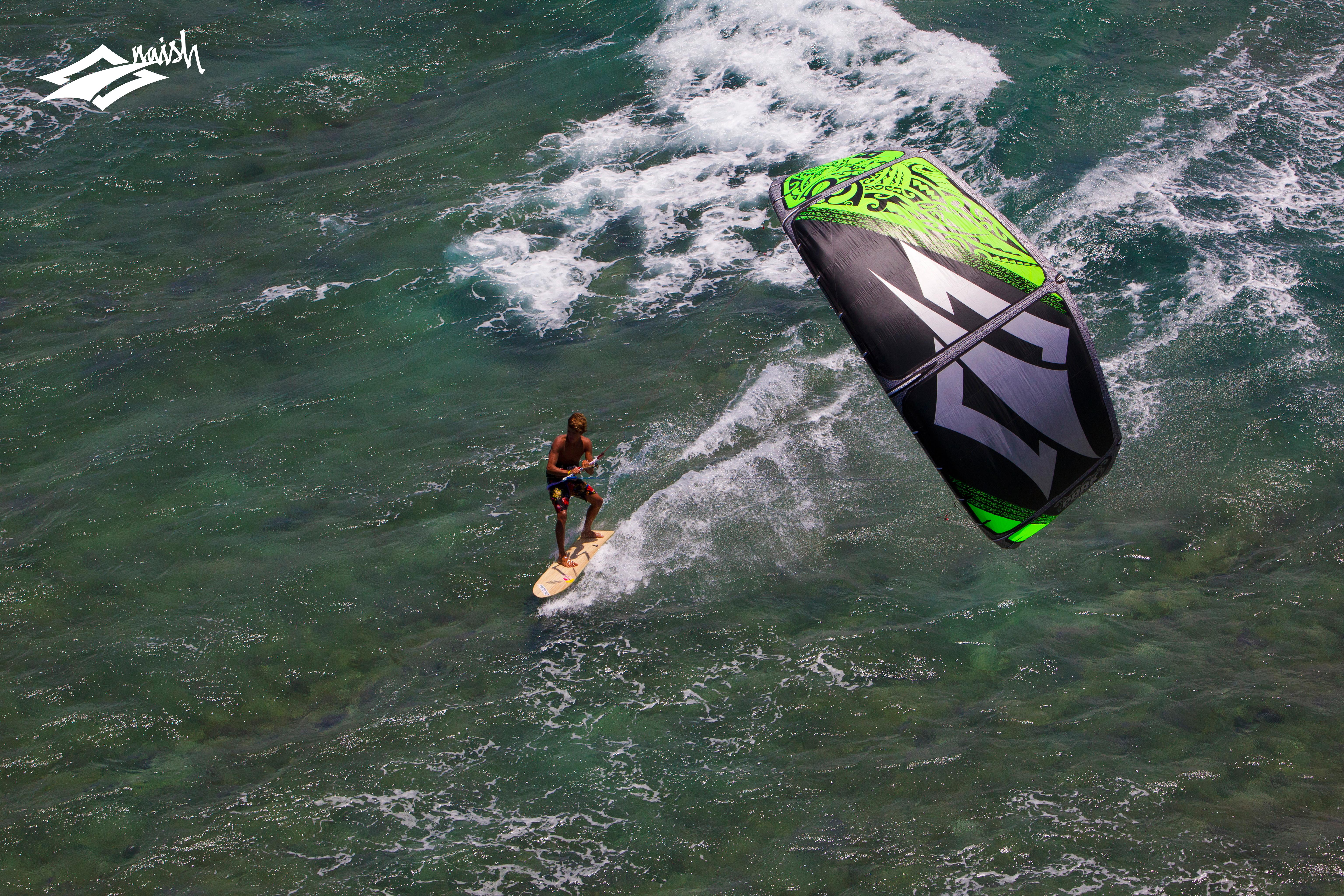 kitesurf wallpaper image - Kai Lenny cruising with the Naish Park kite and Alaia kiteboard off Hawaii - in resolution: Original 6144 X 4096