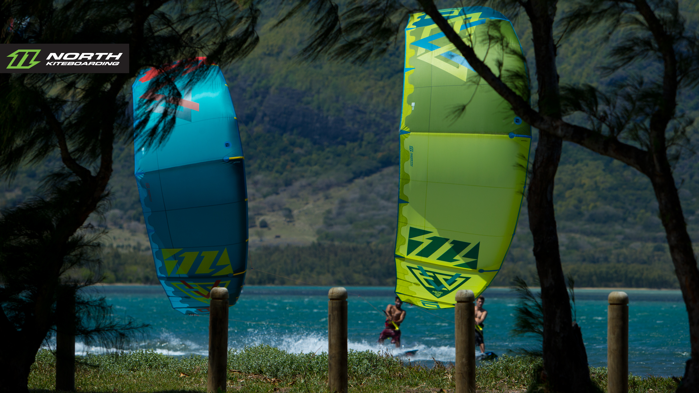 kitesurf wallpaper image - North Evo 2015 duo cruising between the trees - kitesurfing - in resolution: High Definition - HD 16:9 2400 X 1350