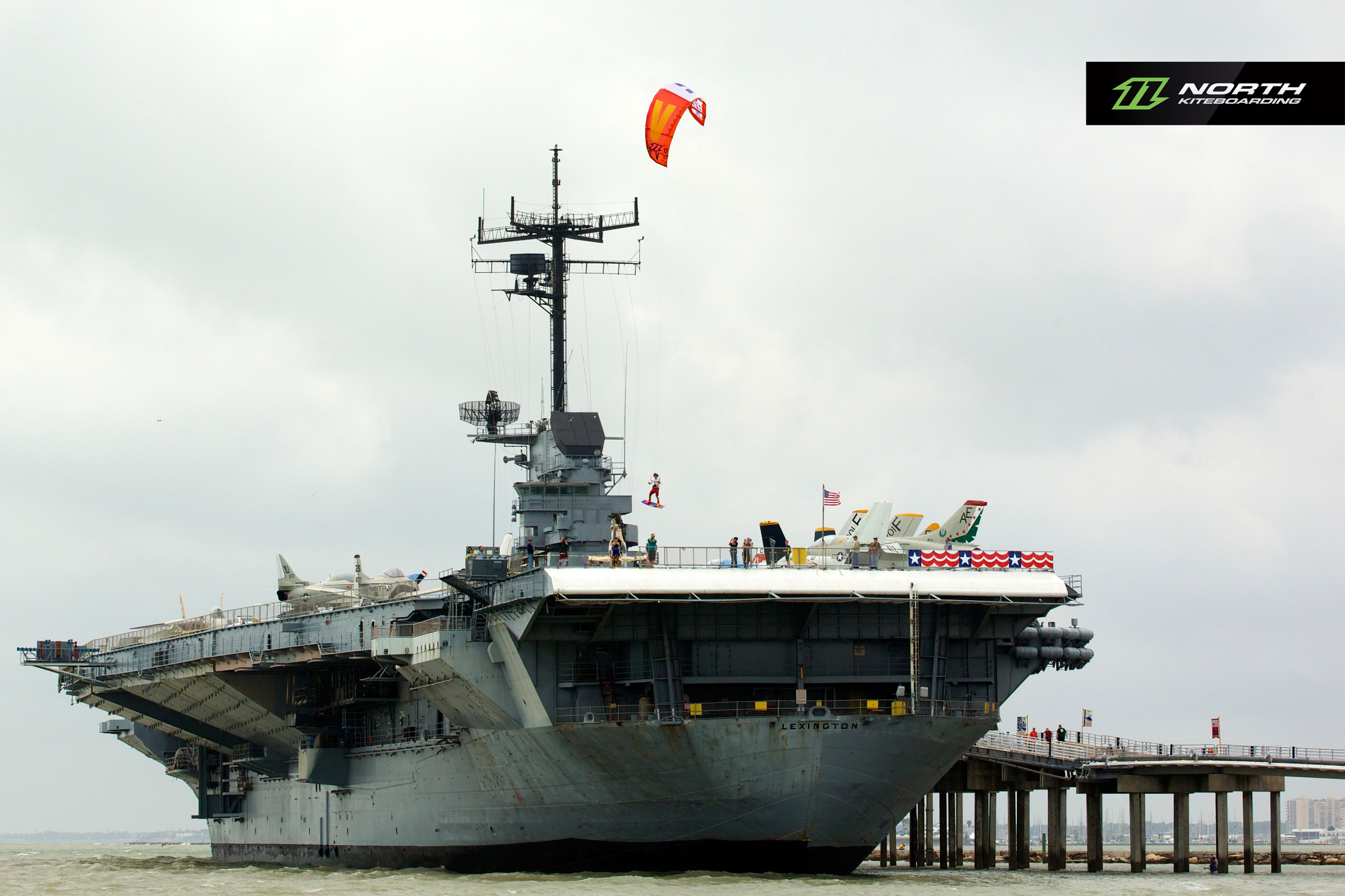 kitesurf wallpaper image - Jumping off an aircraft carrier with a North Vegas kite - in resolution: Original 2222 X 1481