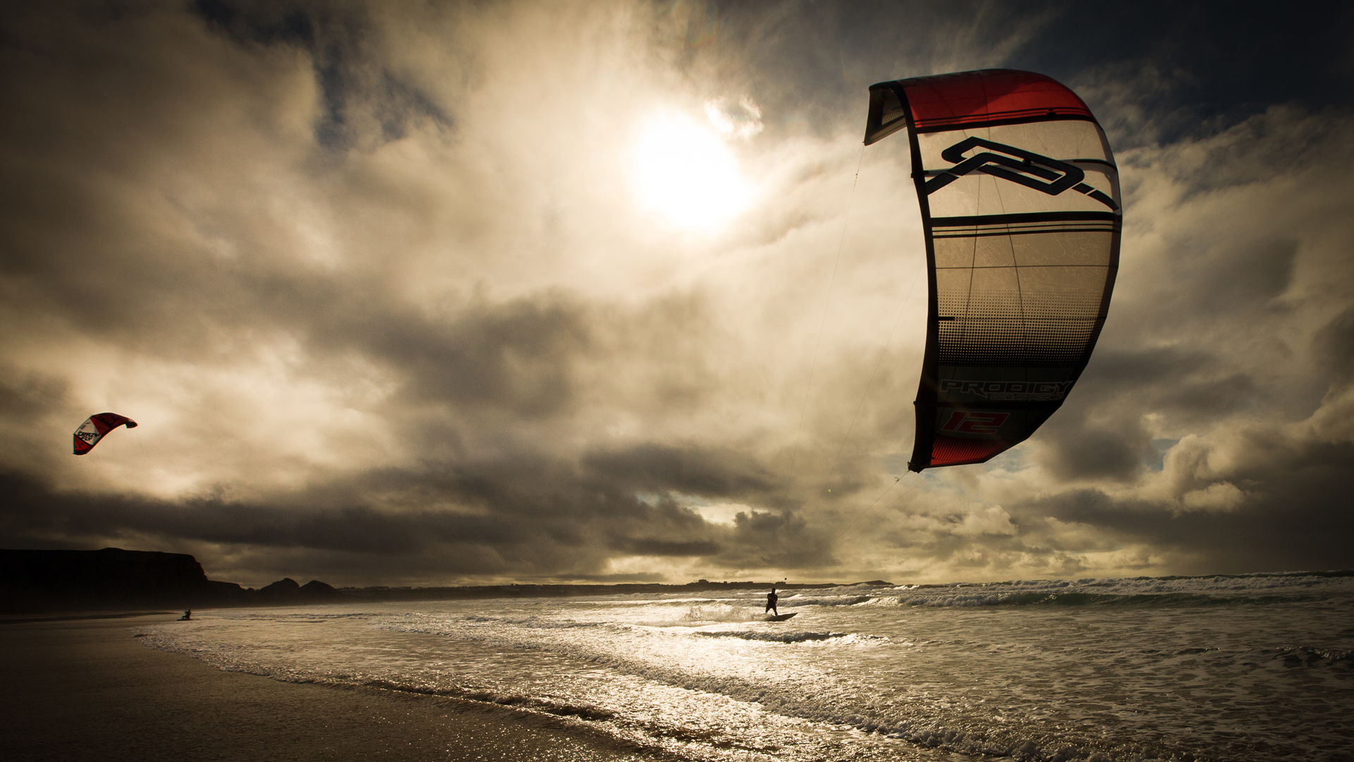 kitesurf wallpaper image - A nice sunset kitesurfing session in the waves. - in resolution: High Definition - HD 16:9 1920 X 1080