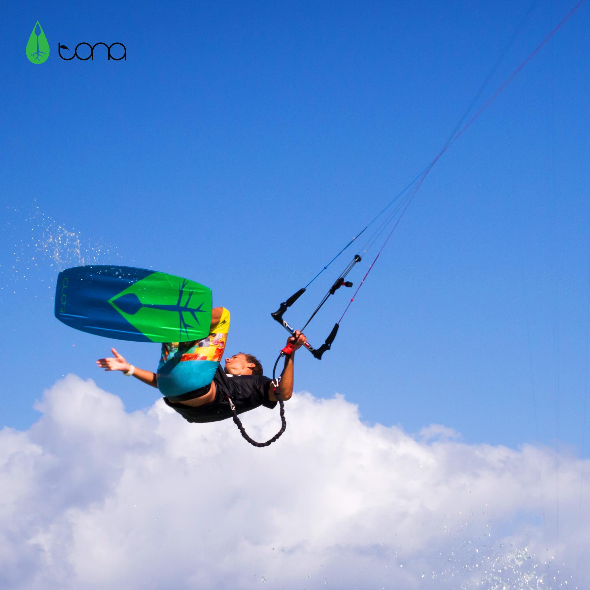 kitesurf wallpaper image - Jake Kelsick on the Tona Pop board handlepassing awefully close a C4 Ozone kite - in resolution: iPad 2 & 3 2048 X 2048