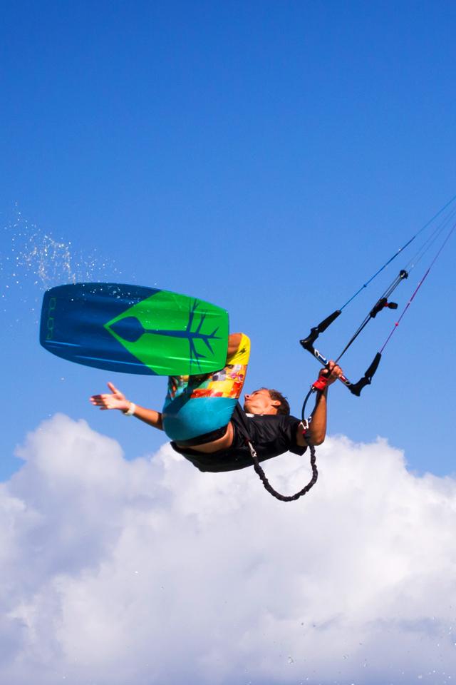 kitesurf wallpaper image - Jake Kelsick on the Tona Pop board handlepassing awefully close a C4 Ozone kite - in resolution: iPhone 640 X 960