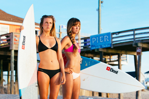 Two Best Kiteboarding kitechicks in bikini with surfboards looking to take a ride