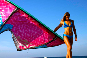 Melissa Gil with the Cabrinha Switchblade kite - in bikini on the beach