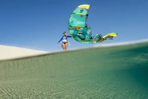 Susi Mai just hanging out with her Cabrinha kite on a sand dune