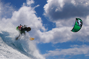 Backside shred by Mitu Monteiro off a wave and on the F-One Bandit kite.