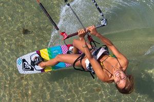Angela Peral leaning back for the camera - kitesurfing