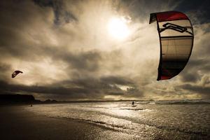 A nice sunset kitesurfing session in the waves.
